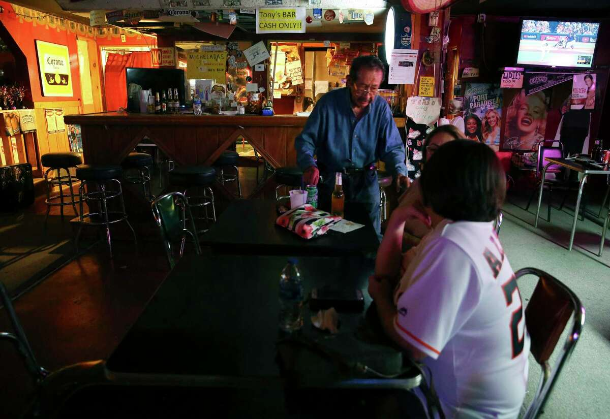 """The classic """"neighborhood dive bar"""" serves $2.50 domestic beers, and slightly more for Mexican brews. (Kin Man Hui/San Antonio Express-News)"""