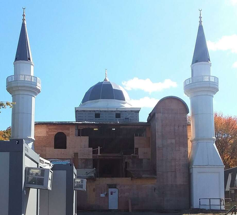 Work has begun on theDiyanet Mosque of New Haven that was badly damaged in an arson fire in May. Photo: Hearst Connecticut Media /