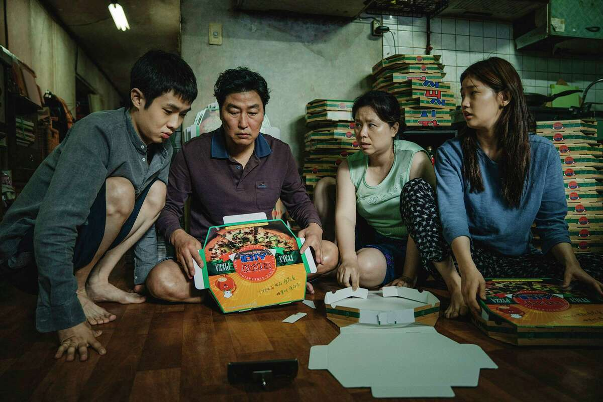 """The Kim family (From left: Choi Woo-shik Choi, Song Kang-ho, Jang Hye-jin and Park So-dam) in """"Parasite."""" MUST CREDIT: Neon/CJ Entertainment"""
