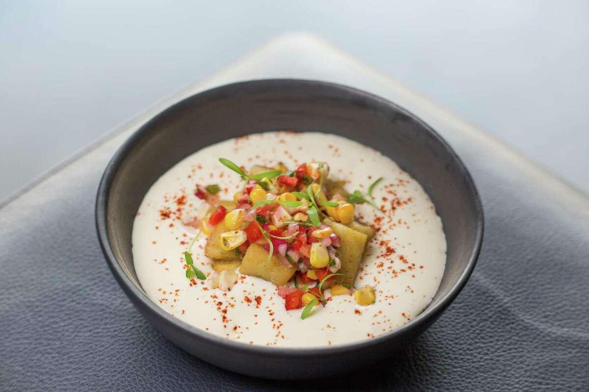 Corn gnocchi with cotija fondue, cilantro and espelette at Riel