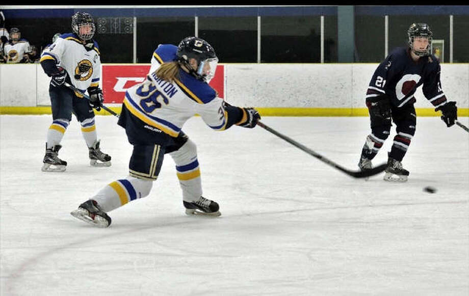 Mattie Norton, playing for the U19 AAA Blues, takes a slap shot from the top of the circle against Team Colorado. Photo: For The Intelligencer