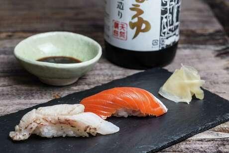 Akamutsu (Japanese sea perch), left, and Fraser River sockeye salmon at Kata Robata