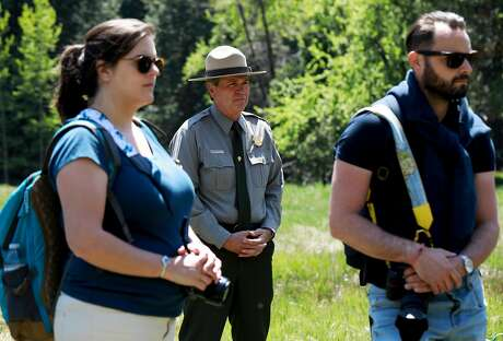 Mike Reynolds, superintendent of Yosemite National Park, listens to a speaker before the release of native red-legged frogs into the water in Cook's Meadow at Yosemite National Park in Yosemite, Calif., on Friday, May 3, 2019. Biologists at Yosemite National Park released frogs, raised at the San Francisco Zoo, into the creeks and waterways in the valley. It's part of a major effort to restore the native populations of the native Sierra species after they were killed off by invasive bullfrogs and a lethal fungus.