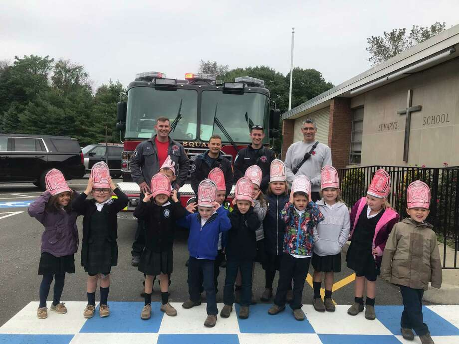 For Fire Safety Month, Milford firefighters visited St. Mary School to talk to preschool and kindergarten students about gear and all the parts of the big trucks. Photo: Contributed Photo.