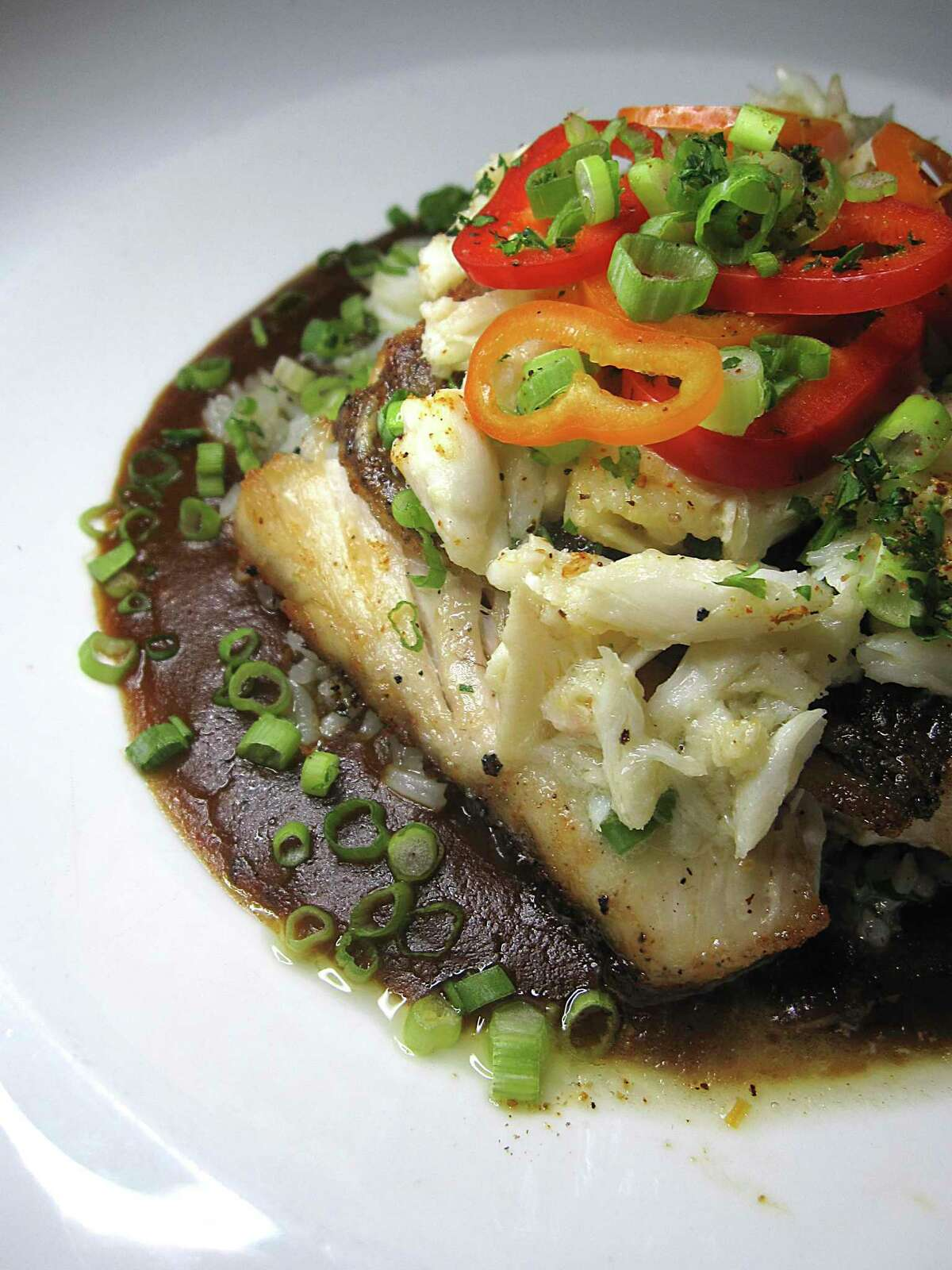 Pan-fried Gulf snapper comes with gumbo sauce and an optional dress of crab meat at Southerleigh Fine Food & Brewery at the Pearl.