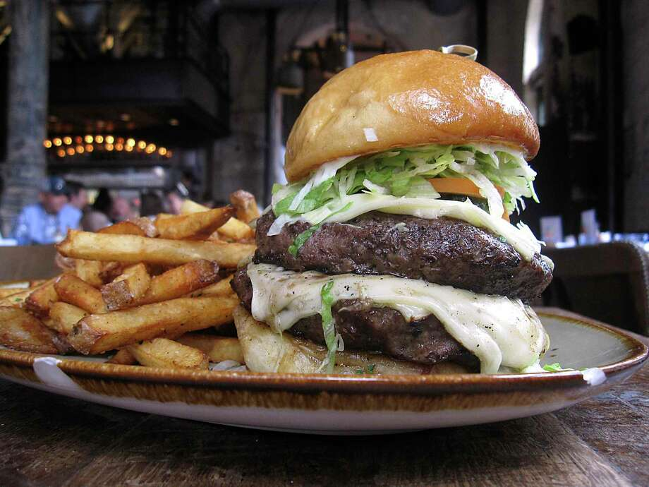 The Dinner Burger comes with two beef patties, cheese, bacon jam and handcut fries at Southerleigh Fine Food & Brewery at the Pearl. Photo: Mike Sutter /Staff