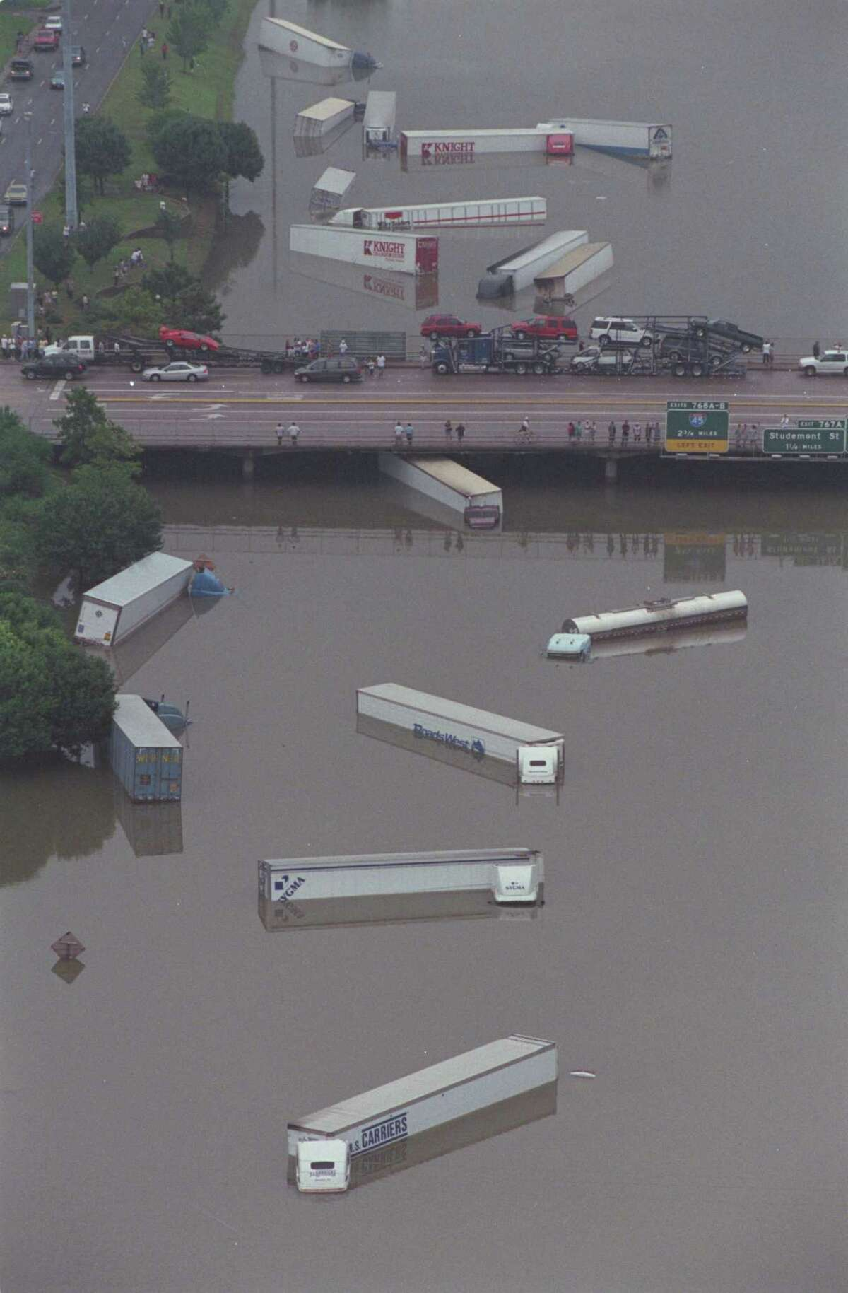Tractor trailers and cars flooded on Interstate 10 under T.C. Jester during Tropical Storm Allison in June 2001.