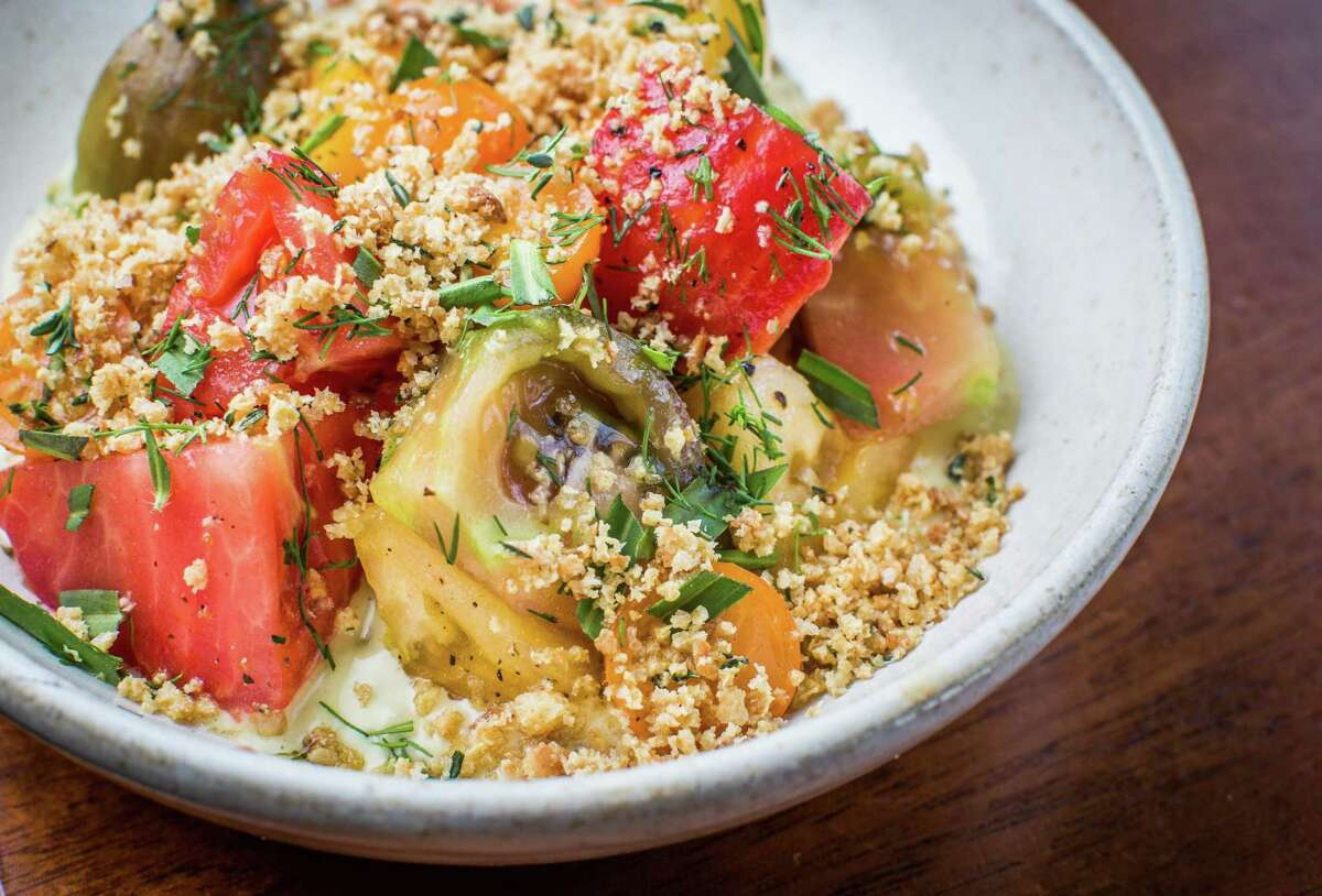 Marinated heirloom tomatoes, tonnato sauce, herbs and bread crumbs at Squable