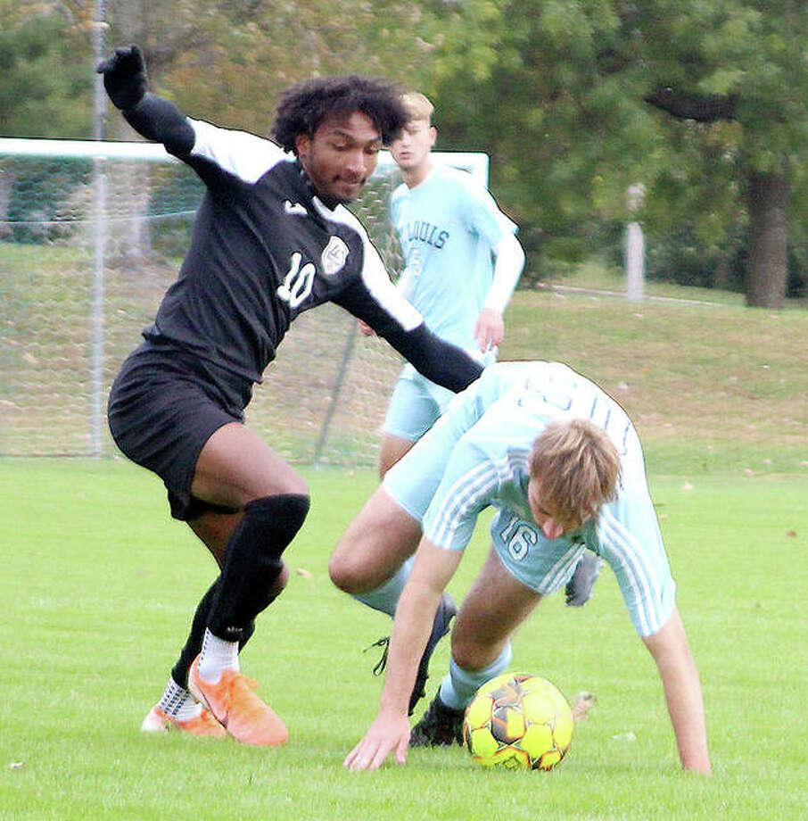 LCCC's Reshaun Walkes, left, battles with James Grainger of STLCC last week. Walkes scored the first goal in his team's 3-1 victory at Florissant Valley. Walkes later suffered an ankle injury when he struck a sprinkler head and has not practiced since. LCCC's men will begin Region 24 play at noon Saturday at home. Photo: Pete Hayes | The Telegraph