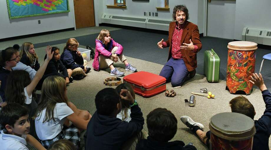 Greens Farms Academy alumnus Charlie Hall leads a music workshop for Greens Farms Academy students during his recent visit to the school. Photo: Contributed