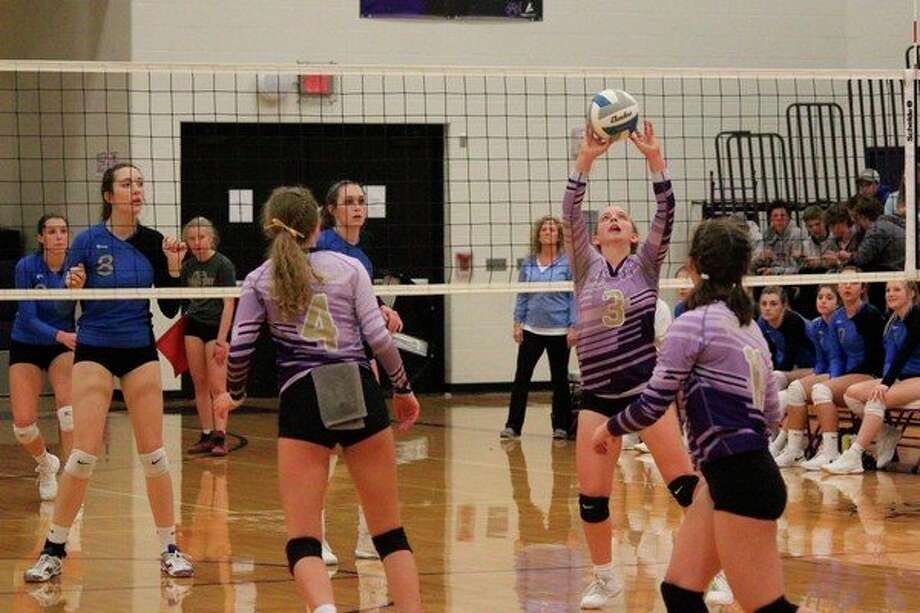 Haley Myers sets the ball for a teammate as the Panthers battle the Portagers in the third set. (Photo/Robert Myers)