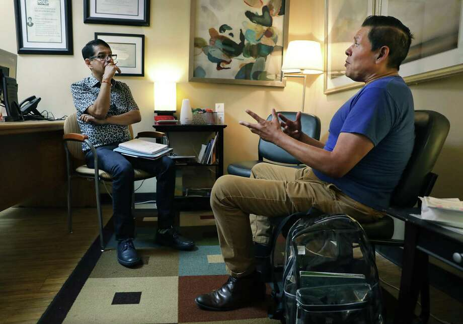 Steven Finees Flores, 52 years old, right, meets with Francisco Ramirez, a counselor at the San Antonio Aids Foundation, for a therapy appointment. / ©2019 San Antonio Express-News