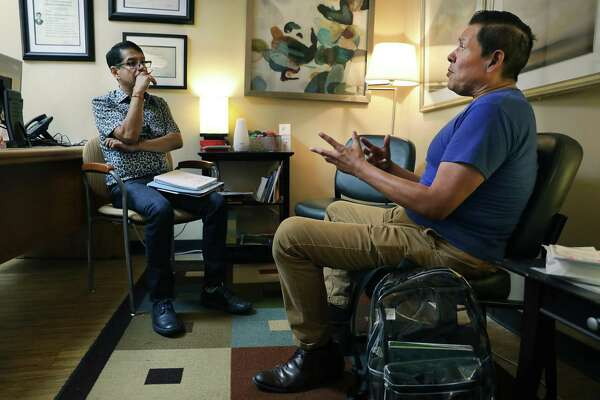 Steven Finees Flores, right, meets with Francisco Ramirez, a counselor at the San Antonio Aids Foundation, for a therapy appointment.