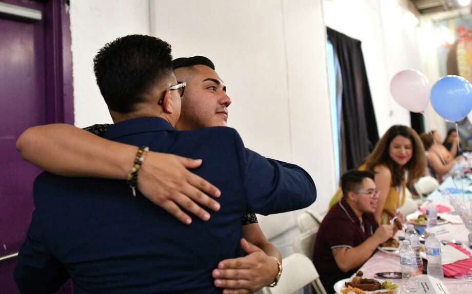 Jacundo Ramos, 23, who was diagnosed with HIV in 2017 shortly after moving to San Antonio from the Lubbock area, embraces Grayson Cabian at the Trans Power SA Pride Summit, which he helped organize. After his diagnosis, Ramos became heavily involved in advocacy surrounding the HIV-positive community. Photo: Billy Calzada / San Antonio Express-News