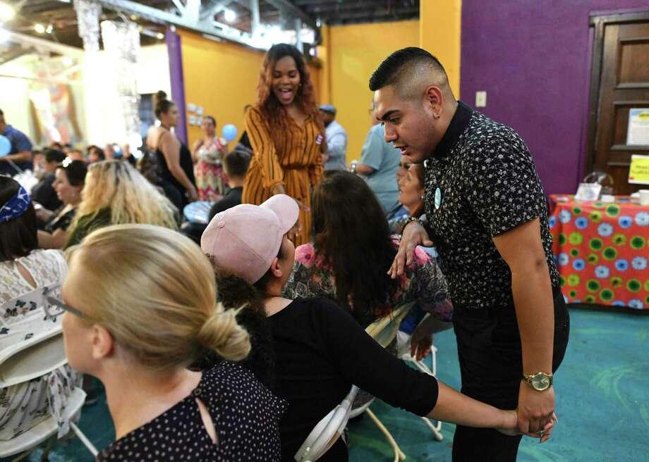 Jacundo Ramos greets people attending the Trans Power SA Pride Summit, held July 27. Photo: Billy Calzada / San Antonio Express-News