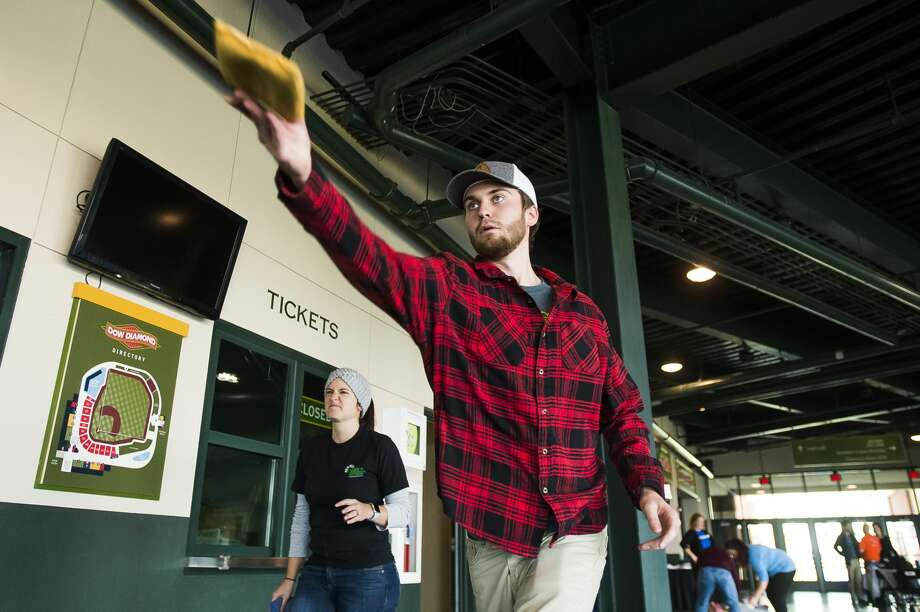 Sawyer Hegyi of Bay City competes in the 2019 Cornhole Classic, hosted by Disability Network and the Great Lakes Loons, Wednesday, Oct. 23, 2019 at Dow Diamond. All proceeds from the inaugural Agency Challenge will benefit United Way of Midland County. (Katy Kildee/kkildee@mdn.net) Photo: (Katy Kildee/kkildee@mdn.net)