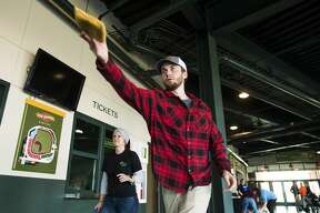 Sawyer Hegyi of Bay City competes in the 2019 Cornhole Classic, hosted by Disability Network and the Great Lakes Loons, Wednesday, Oct. 23, 2019 at Dow Diamond. All proceeds from the inaugural Agency Challenge will benefit United Way of Midland County. (Katy Kildee/kkildee@mdn.net)