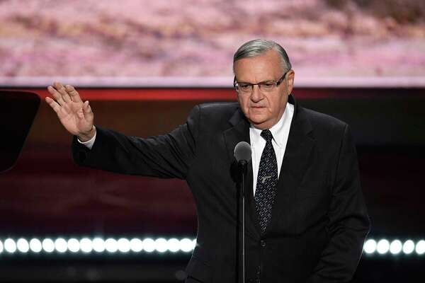 Joe Arpaio, then sheriff of Maricopa County, Ariz., waves while speaking during the Republican National Convention in Cleveland on July 21, 2016.