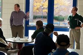 Midland High assistant football coach Matt Starling, left, and Dow High head football coach Jason Watkins spoke at Wednesday's monthly Midland sports luncheon at Northwood, which focused on Friday's upcoming 50th annual Midland vs. Dow rivalry football game at Midland Community Stadium.