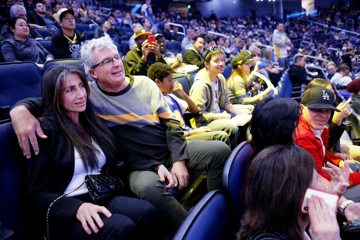 From left: Nadia McCroden and Brian McCroden at Chase Center for the NBA preseason game between the Golden State Warriors and Los Angeles Lakers on Friday, Oct. 18, 2019, in San Francisco, Calif. They are Golden State Warriors season-ticket holders.