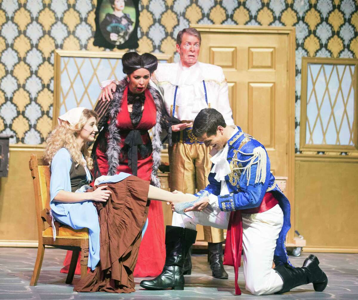 The prince, Lucas Olivarez, places the glass slipper on Cinderella's foot. Kathleen Baker plays Cinderella. The show has its last run today at 2 p.m. at the Crighton Theatre.