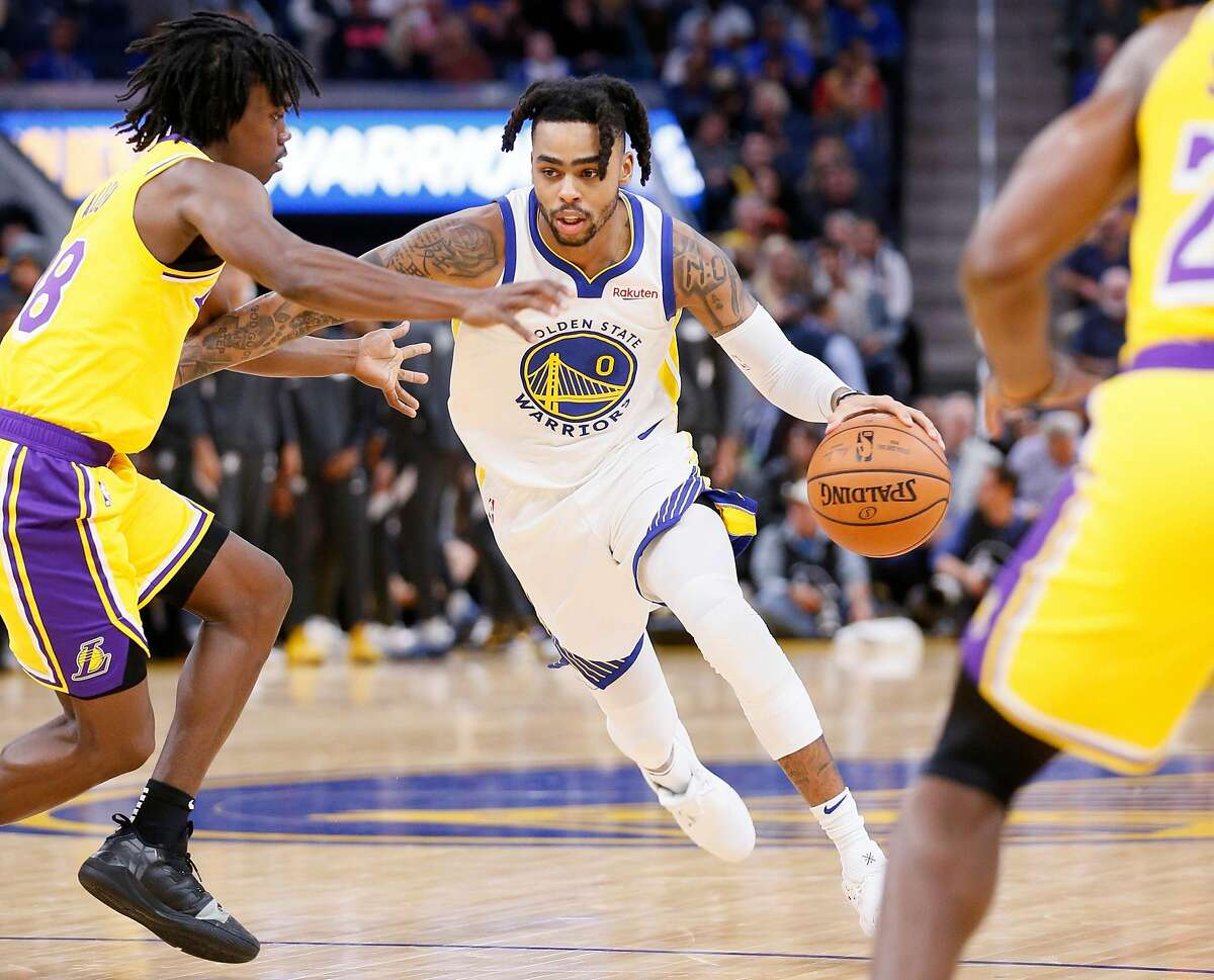 Golden State Warriors guard D'Angelo Russell (0) dribbles against Los Angeles Lakers Marcus Allen (28) during an NBA preseason game at Chase Center on Friday, Oct. 18, 2019, in San Francisco, Calif.