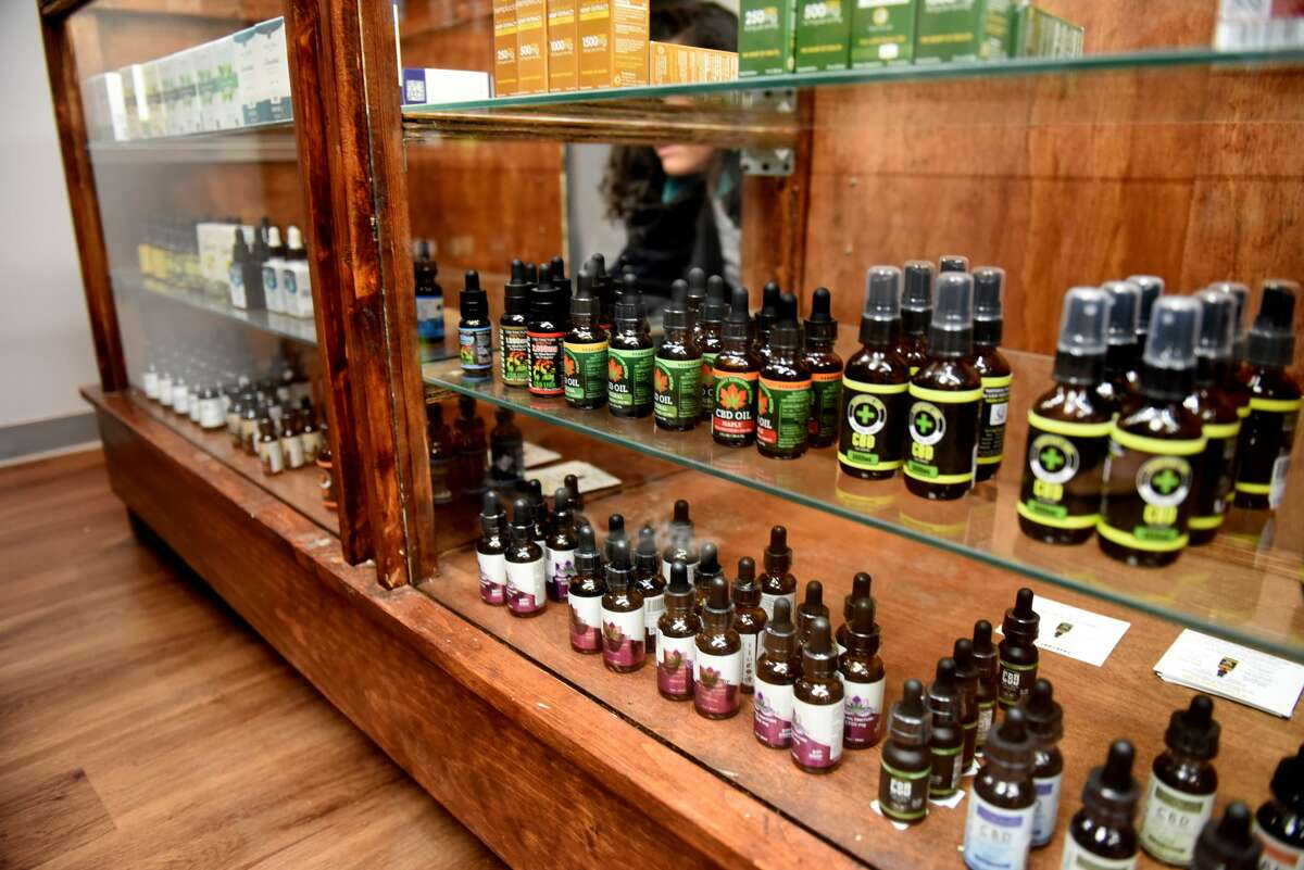 CBD oils are displayed at Upstate CBD on Upper Union Street store on Tuesday, June 4, 2019, in Schenectady, N.Y. The shop offers CBD hemp buds, edibles, extractions, topicals and pet products. Store owner Donald Andrews hopes the business will give him a foothold should New York legalize recreational marijuana. (Will Waldron/Times Union)
