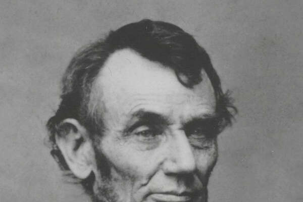 A photograph of Abraham Lincoln, U.S. President from 1861-1865, taken during a sitting at Matthew Brady's Washington studio in February, 1864. At left is the three-quarters portrait that was adapted for the front of the five-dollar bill;
