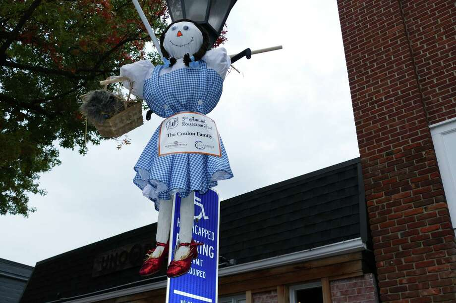 Dorothy with her rubby slippers was hanging around a lampost on Elm Street, created by the Coulon family, as part of the third annual scarecrow contest that will benefit the YWL Giving Fund. Photo: Grace Duffield /