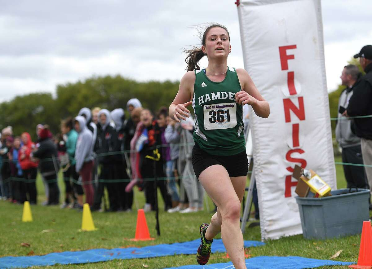 Hamden's Ella Bradford races to victory at the SCC championships at East Shore Park in New Haven.