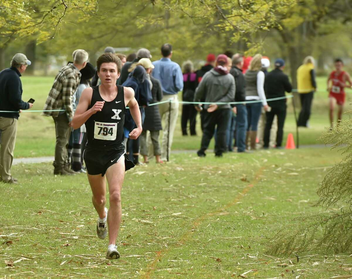 New Haven, Connecticut - Thursday, October 17, 2019: First place finisher Robbie Cozean of Xavier H.S. runs the course, left, followed by second place finisher Brendan Mellitt of Cheshire H.S., right, during the SCC Boys Cross Country Championship Thursday afternoon at East Shore Park in New Haven.