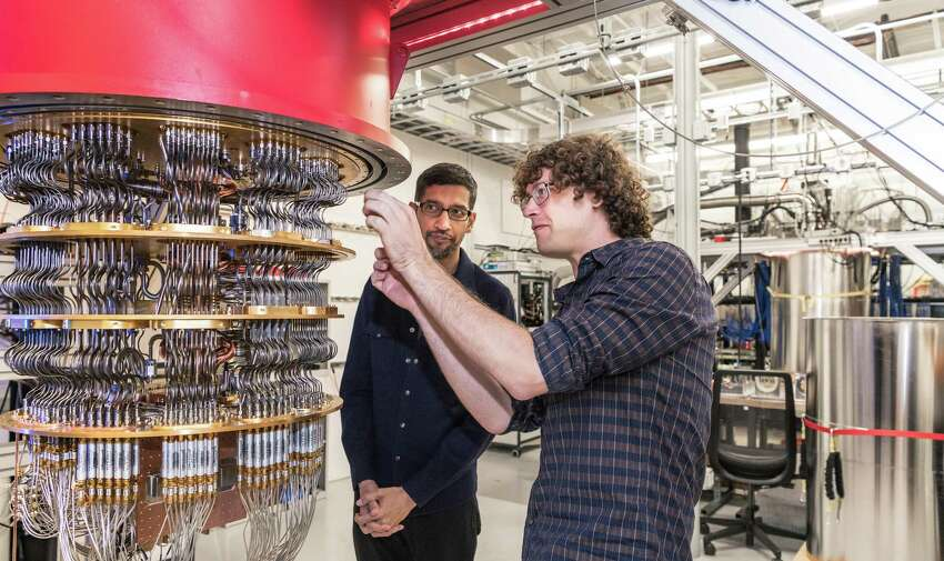 A photo provided by Google shows, from left, Sundar Pichai, the chief executive, and a Google researcher with Google's quantum computer machine. Google said on Wednesday, Oct. 23, 2019, that it had achieved a long-sought breakthrough called a€œquantum supremacy,a€ which could allow new kinds of computers to do calculations at speeds that are inconceivable with todaya€™s technology. (Google via The New York Times) -- NO SALES; FOR EDITORIAL USE ONLY WITH NYT STORY SCI QUANTUM COMPUTING BY CADE METZ FOR OCT. 23, 2019. ALL OTHER USE PROHIBITED. --