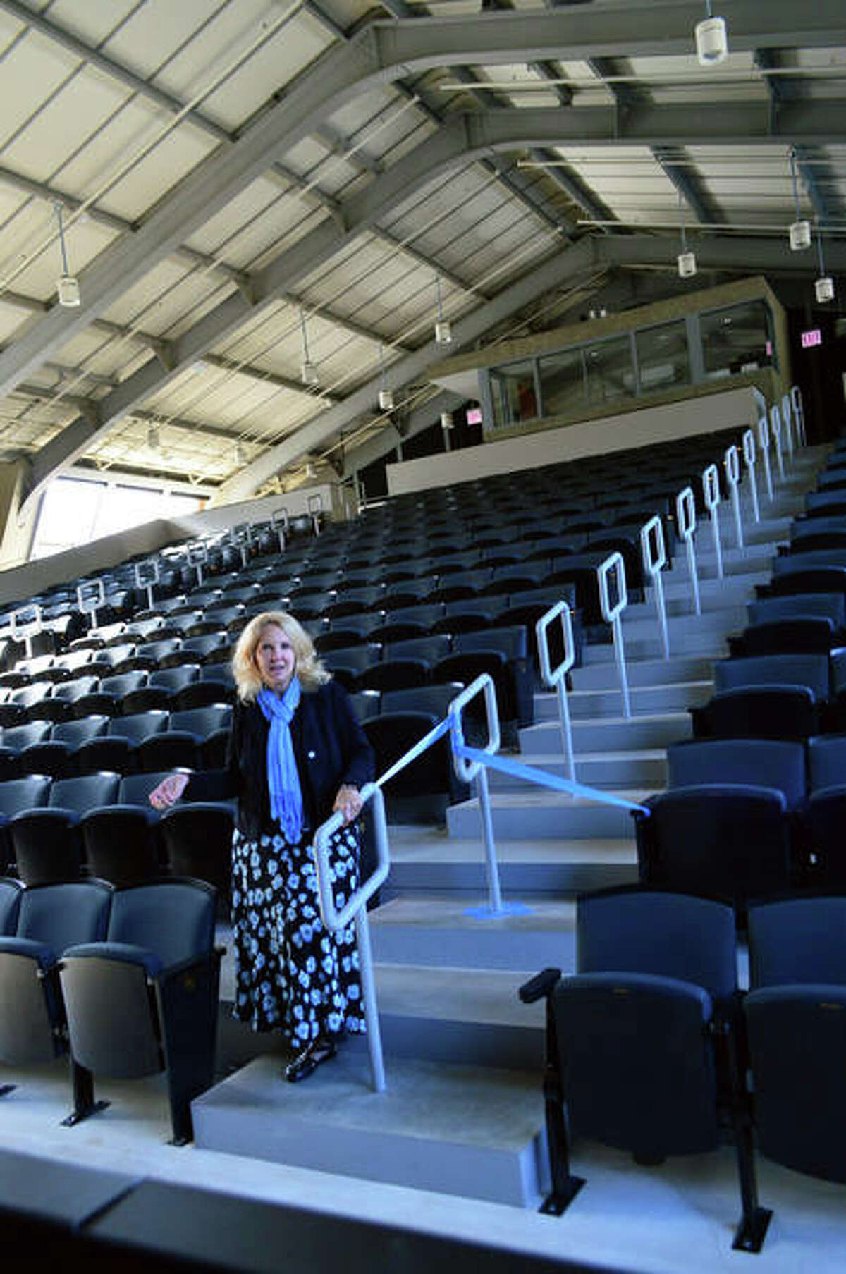 Sue Ellen Coughtry, senior philanthropy advisor at Principia, lends perspective to the stadium seating in the Robert Duvall Theatre, designed to ensure the view is unobstructed from any seat in the house.