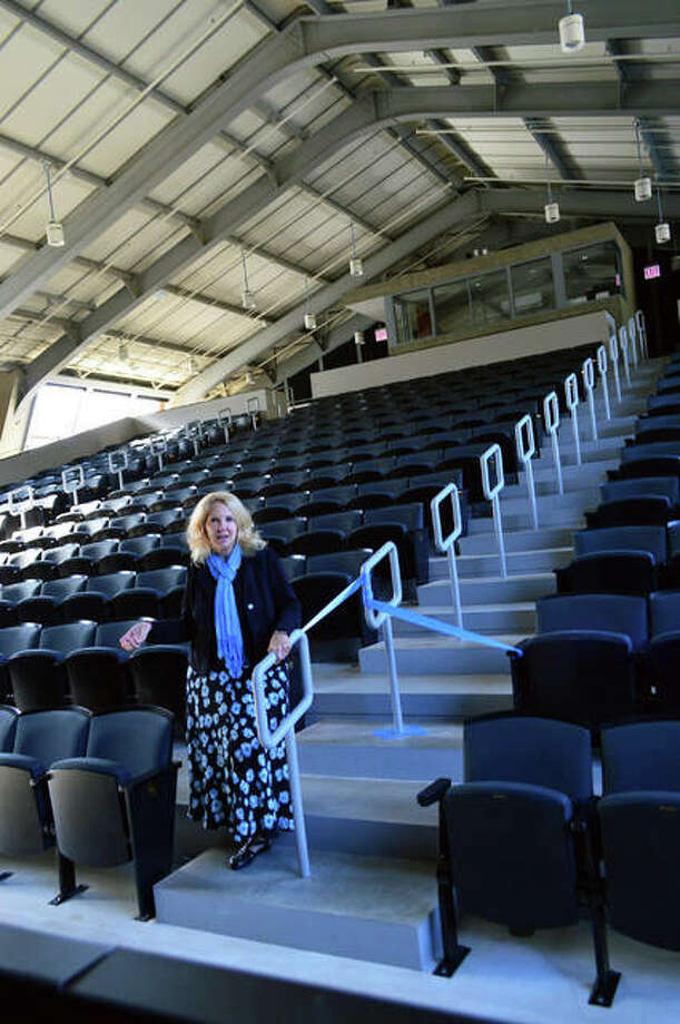 Sue Ellen Coughtry, senior philanthropy advisor at Principia, lends perspective to the stadium seating in the Robert Duvall Theatre, designed to ensure the view is unobstructed from any seat in the house. Photo: Vicki Bennington | For The Telegraph