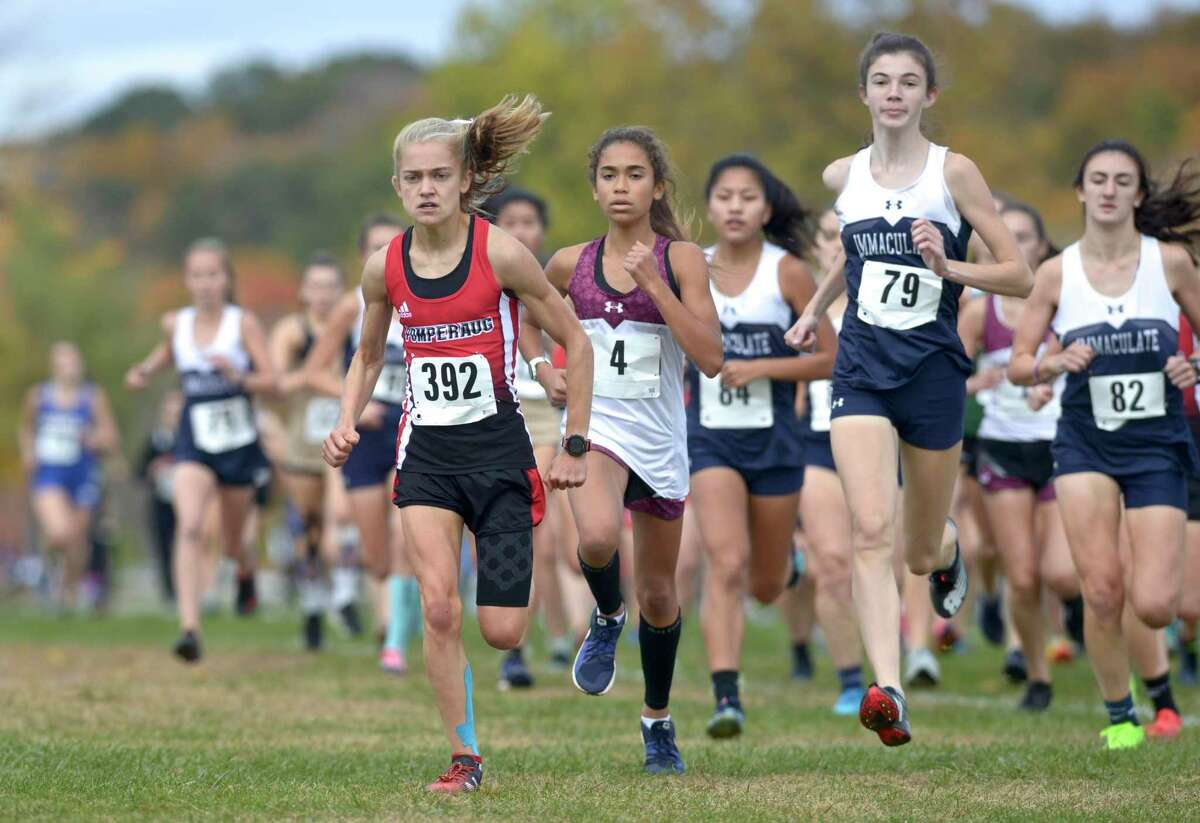 Pomperaug's Kate Wiser (392), Bethel's Ava Grahm (4) and Immaculate's Ailene Doherty (79) lead the pack at the start of the girls SWC cross country championship race, Friday afternoon, October 18, 2019, at Bethel High School, Bethel, Conn. Wiser finished first, Grahm third and Doherty forth in the race.