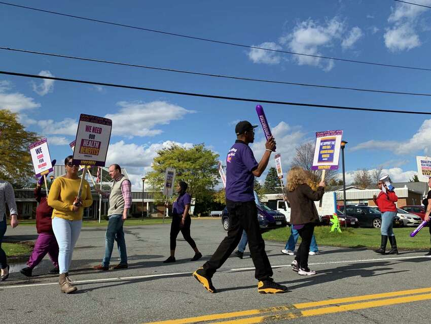 Employees at Good Samaritan Nursing Home and Kenwood Manor in Delmar picketed outside the facilities on Wednesday, Oct. 23, 2019 to demand their employer, The Lutheran Care Network, pay outstanding dues owed to their health benefit fund. The financially troubled company faces the prospect of bankruptcy and is currently in the process of trying to sell the facilities, employees say. (Bethany Bump/Times Union)