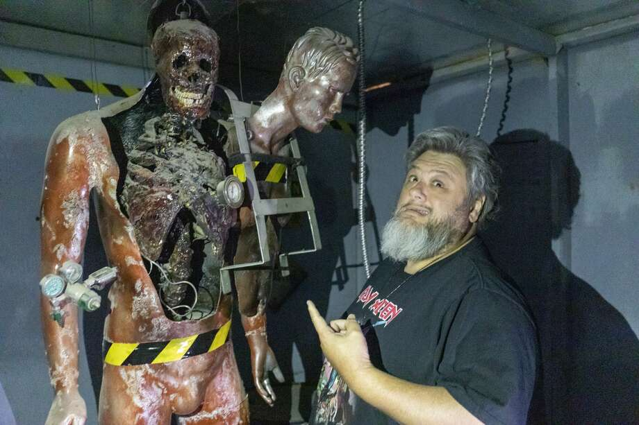 Billy Pon poses with a prop in his haunted warehouse Oct. 11, 2019 at Def Con 1.  Jacy Lewis/Reporter-Telegram Photo: Jacy Lewis/Reporter-Telegram