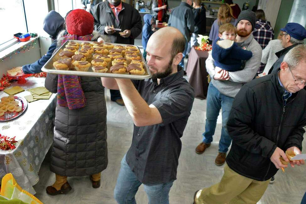 Co-op member Avery Cotton brings out another tray of Peanut Butter Fudge Cups during the Naughty or Nice Cookie Challenge at Honest Weight Food Co-op Saturday Dec. 1, 2018 in Albany, NY. (John Carl D'Annibale/Times Union)