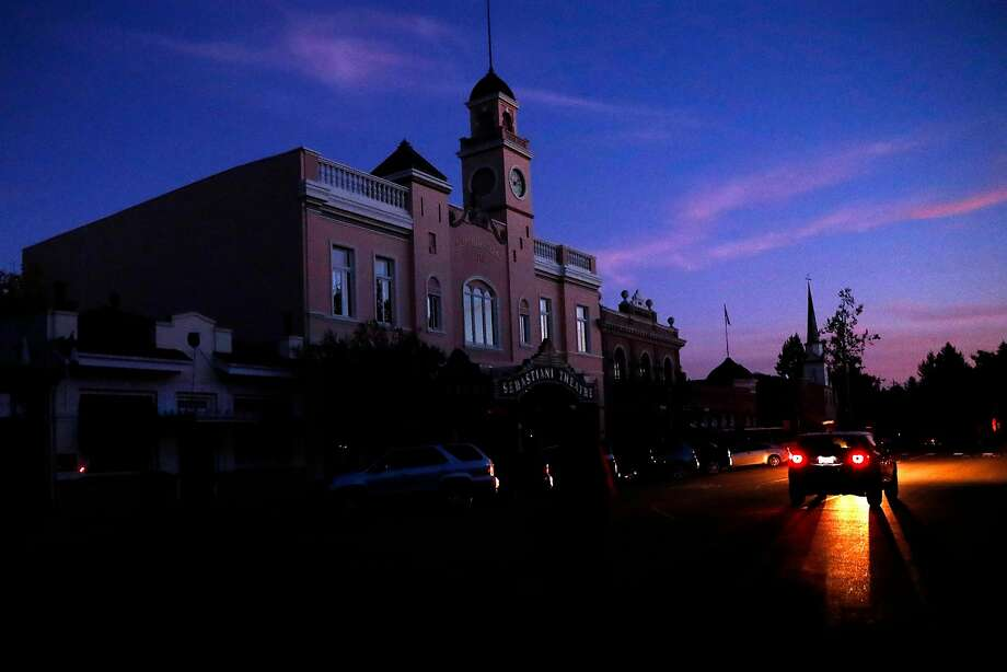 The sun sets on the Sonoma town square as PG&E power shutoffs continue. Photo: Scott Strazzante / The Chronicle