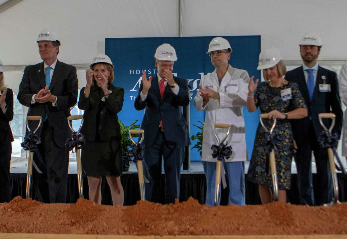 Houston Methodist CEO Marc Boom (center) and guests applaud after turning dirt during a ground breaking ceremony Friday, September 27, 2019 at Houston Methodist The Woodlands Hospital.
