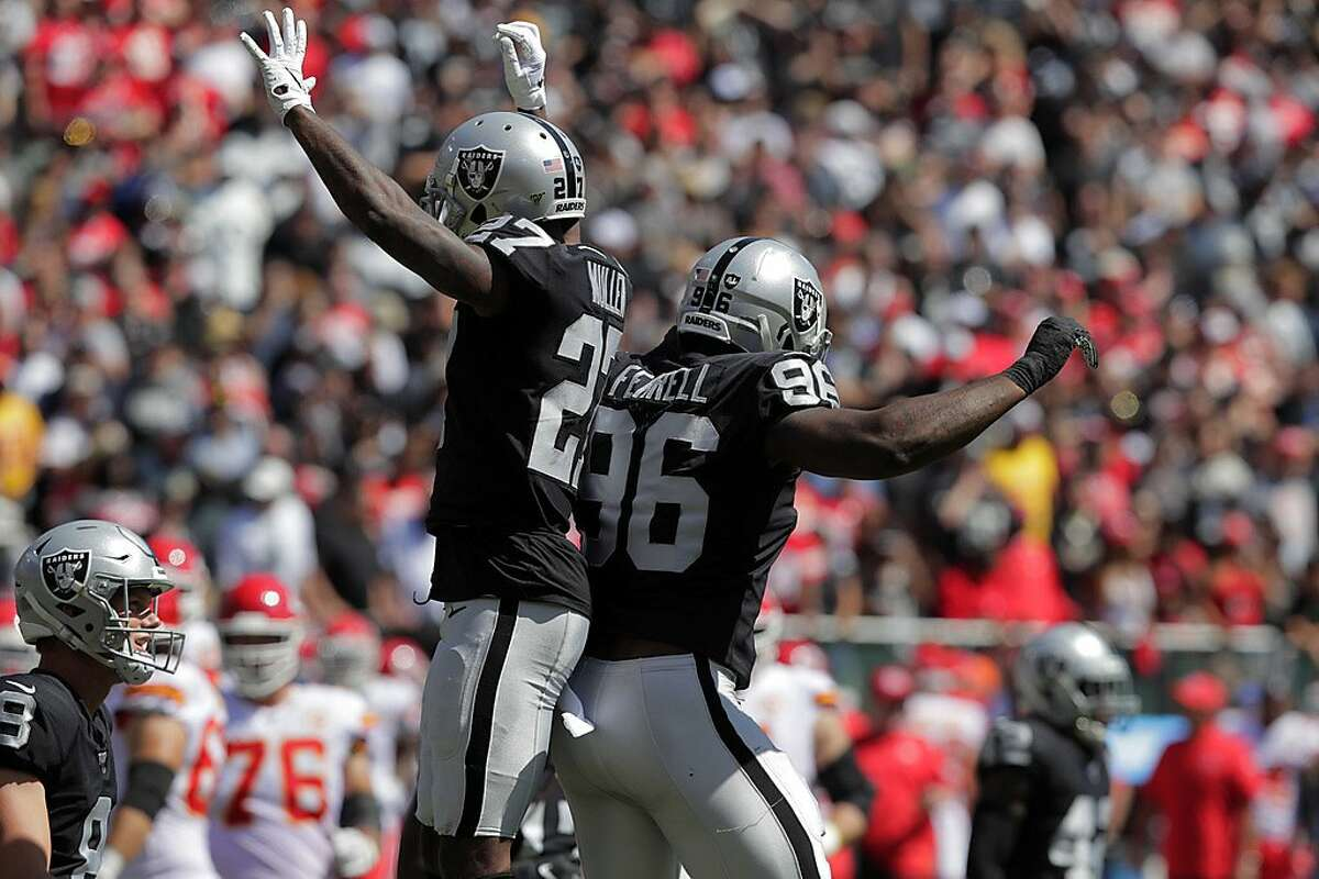 Trayvon Mullen (27) and Clelin Ferrell (96) celebrate stopping a run In the first half as the Oakland Raiders play the Kansas City Chiefs in the coliseum in Oakland, Calif., on Sunday, September 15, 2019.