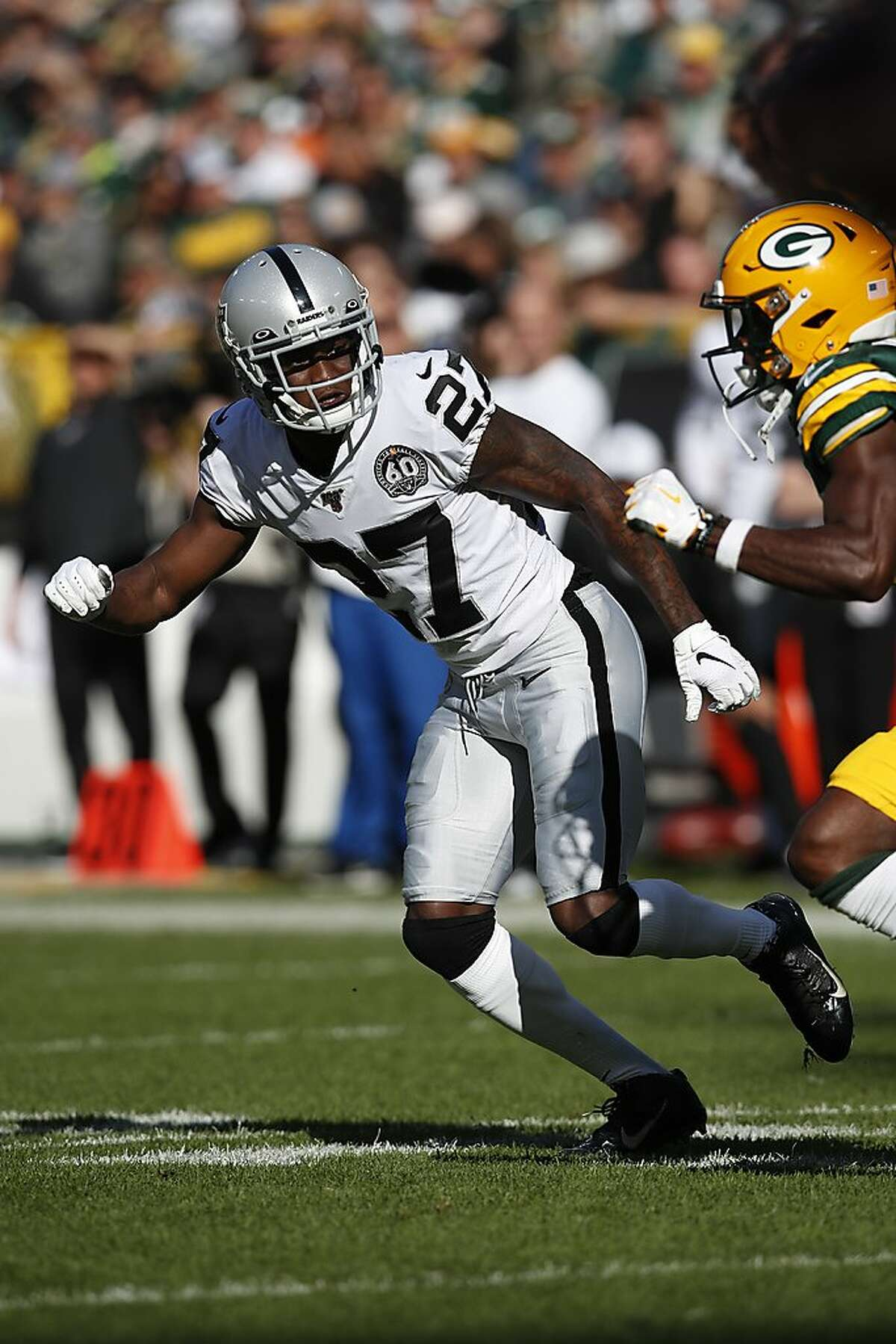 Oakland Raiders cornerback Trayvon Mullen (27) defends against the Green Bay Packers during an NFL football game Sunday, Oct. 20, 2019, in Green Bay, Wis. The Packers won the game 42-24. (Jeff Haynes/AP Images for Panini)