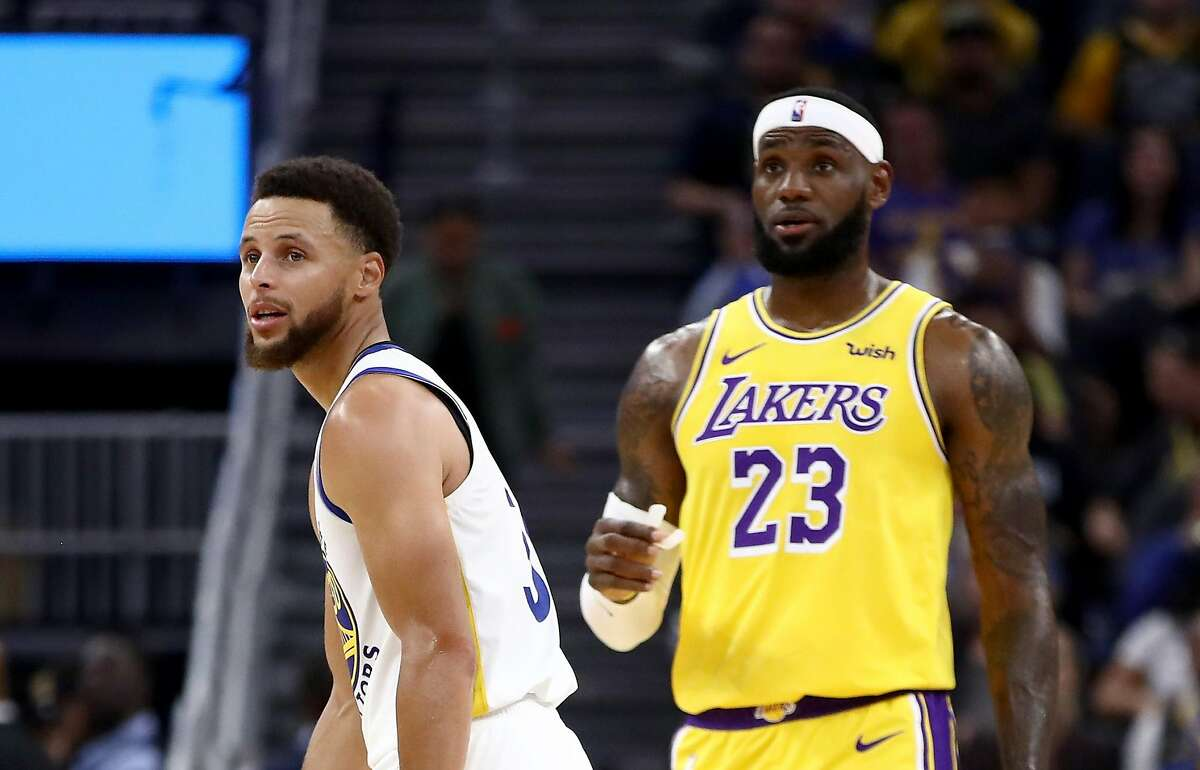 LeBron James talks to Stephen Curry during their game at Chase Center on Oct. 05, 2019.