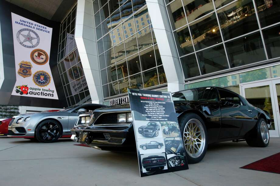 The 1978 Pontiac Pro Touring Bandit Edition Trans Am, once owned by actor Burt Reynolds, is displayed in Sacramento, Calif., Wednesday, Oct., 23, 2019. The car was among the vehicles seized by the federal government that that will be auctioned off Saturday Oct. 26. The vehicle owners have not been charge with any crime, but their San Francisco Bay Area solar energy company has been implicated in what federal prosecutors say was a massive scheme that defrauded investors of $1 billion.  (AP Photo/Rich Pedroncelli) Photo: Rich Pedroncelli/AP / Copyright 2019 The Associated Press. All rights reserved