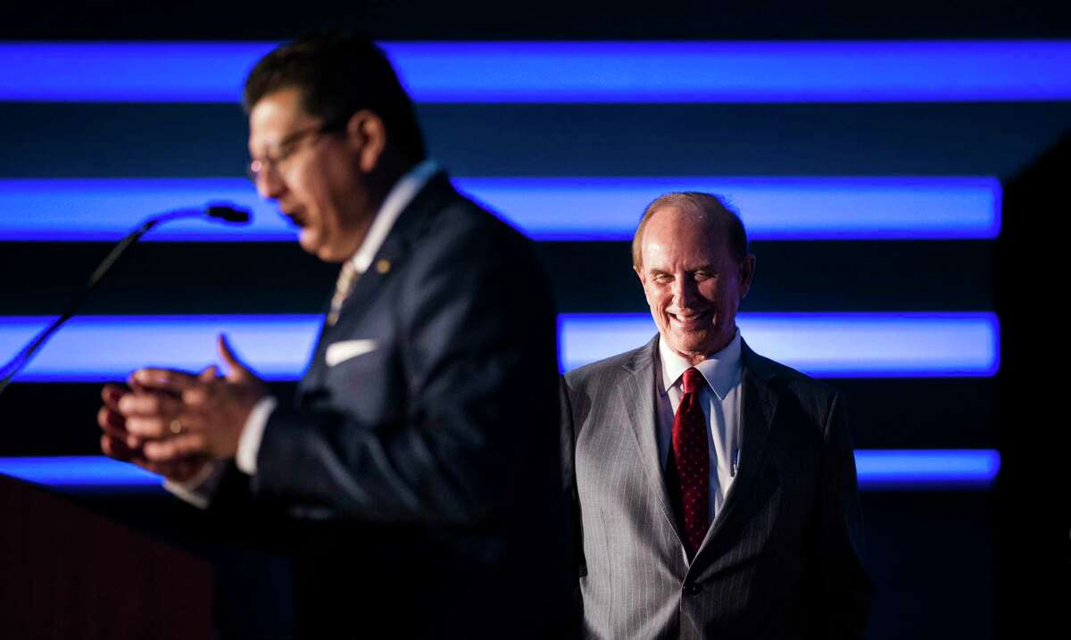 Richard Perez, left, thanks Bexar County Judge Nelson Wolff after Wolff delivered the annual State of the County Address in 2019.