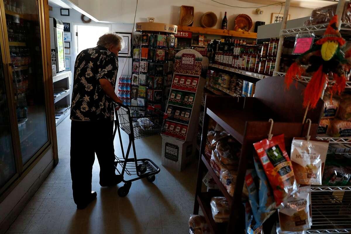 Clive Egerton shops at Oakmont Village Market during PG&E power shut-off in Santa Rosa, Calif., on Wednesday, October 23, 2019.