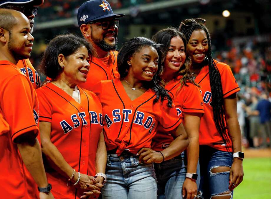 PHOTOS: Which celebrities were at Game 2 of the World Series Simone Biles is photographed before throwing out the ceremonial first pitch before Game 2 of the World Series at Minute Maid Park in Houston on Wednesday, Oct. 23, 2019. Browse through the photos above to see which celebrities were at Game 2 of the Astros-Nationals World Series ... Photo: Brett Coomer, Staff Photographer / © 2019 Houston Chronicle