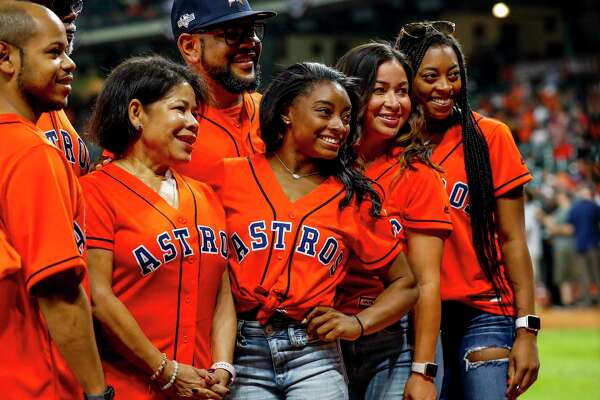 Simone Biles is photographed before throwing out the ceremonial first pitch before Game 2 of the World Series at Minute Maid Park in Houston on Wednesday, Oct. 23, 2019.
