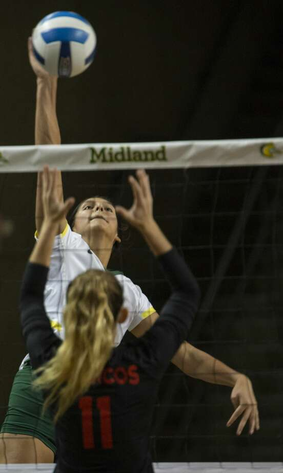 Midland College's Lauren Watanabe looks for a kill as New Mexico Military Institute's Julia Johnson goes up to block 10/23/19 at the Chaparral Center. Tim Fischer/Reporter-Telegram Photo: Tim Fischer/Midland Reporter-Telegram