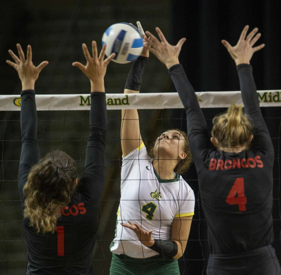 Midland College's Lina Espejo Ramirez goes up for the hit as New Mexico Military Institute's Violeta Mendoza Quintana and Alyssa Lukasik try to block 10/23/19 at the Chaparral Center. Tim Fischer/Reporter-Telegram Photo: Tim Fischer/Midland Reporter-Telegram